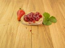 Strawberries jam. Strawberries fresh jam bowl leaf Royalty Free Stock Photo