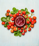Strawberries  jam-jar and fresh berries plant from garden. Strawberries preserving. Stock Images