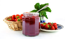 Strawberries and jam in jar Stock Photos