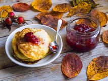 Strawberries jam jars and pancakes. On the wooden table as the autumn background Stock Image