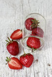 Strawberries. In jar on old vintage white wood table Stock Photography