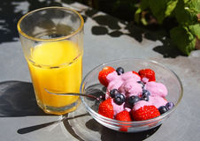 Strawberries, jogurt and juice. In a sunny summer garden stock photography