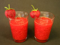 Strawberries juice. Fresh strawberries juice in two glasses stock photography
