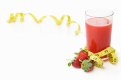 Strawberries and juice with measuring tape Royalty Free Stock Image