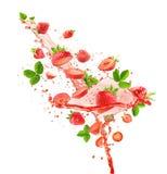 Strawberries with juice splash isolated on the white background Stock Photo