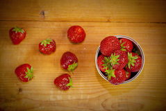 Strawberries. Juicy, fresh strawberries in a cup on the table Royalty Free Stock Images