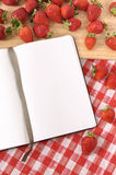 Strawberries kitchen wood board, cookbook, copy space Stock Photo