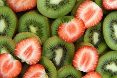Strawberries and Kiwi. Close up of strawberries and kiwi slices Royalty Free Stock Photography