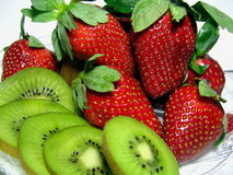 Strawberries with Kiwi Fruit. Macro photograph of fresh strawberries and sliced kiwi fruit Stock Photos