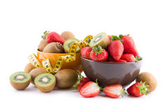 Strawberries and kiwi fruits Stock Photos