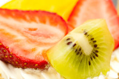 Strawberries kiwi and slice of peach Stock Photography