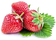Strawberries with leaves isolated on a white. Royalty Free Stock Photo