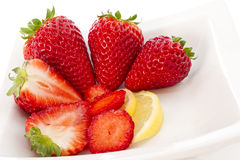 Strawberries and Lemmon on white plate Royalty Free Stock Photography