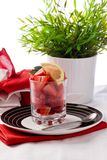 Strawberries with lemon Stock Images
