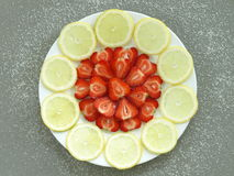 Strawberries with lemon Stock Image
