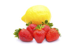 Strawberries and lemon Stock Photos