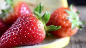 Strawberries and lemon soft focus stock video