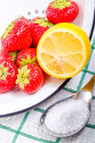 Strawberries with lemon and sugar Royalty Free Stock Images