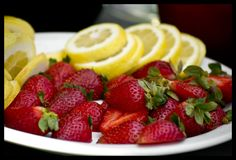Strawberries and lemon on a plate stock image