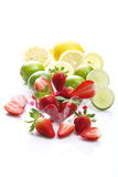 Strawberries, lemons and limes Royalty Free Stock Images