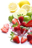 Strawberries, lemons and limes Royalty Free Stock Photography