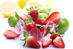 Strawberries, lemons and limes Stock Images