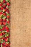 Strawberries lies on sackcloth Royalty Free Stock Photos