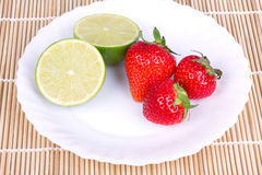 Strawberries and lime Stock Images