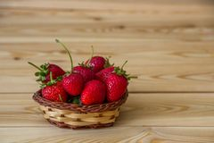 Strawberries in a little basket. Fresh strawberry Stock Photos