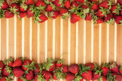 Strawberries lying on bamboo mat Stock Images