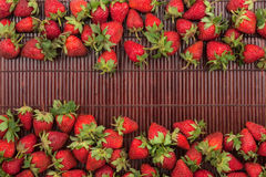 Strawberries lying on bamboo mat Royalty Free Stock Photos