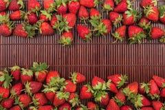 Strawberries lying on bamboo mat Royalty Free Stock Photos