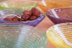 Strawberries macedoine in colored bowls Royalty Free Stock Images