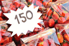 Strawberries in a market with price tag Stock Images