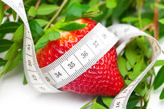 Strawberries and measure tape Royalty Free Stock Photo