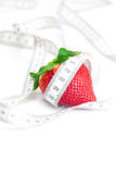Strawberries and measure tape Royalty Free Stock Images