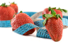 Strawberries with a measure tape stock images
