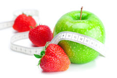 Strawberries,measure tape and apple  isolated Stock Photography