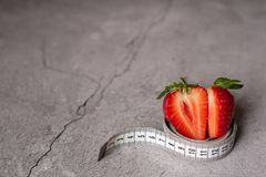 Strawberries with measure tape, healthy life concept royalty free stock images