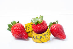 Strawberries with measuring tape Royalty Free Stock Photo