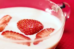 Strawberries in milk Stock Photo