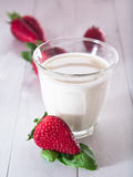 Strawberries with milk Stock Photos