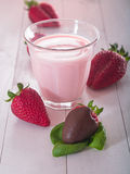 Strawberries with milk Stock Images