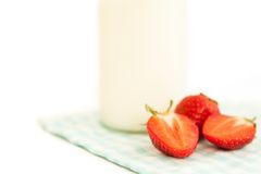 Strawberries and milk isolated on white as healthy eating backgrounds Stock Photos