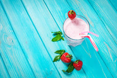 Strawberries milk shake and fresh fruit strawberry. Cocktail with milk Stock Image
