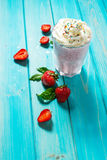Strawberries milk shake and fresh fruit strawberry. Cocktail with milk Stock Images