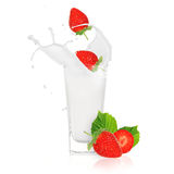 Strawberries with milk splash. Over white Stock Photography