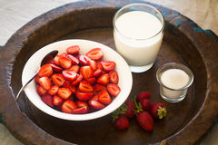 Strawberries with milk and sugar. Strawberries in a bowl with milk and sugar Stock Images