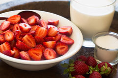 Strawberries with milk and sugar. Strawberries in a bowl with milk and sugar Royalty Free Stock Photos