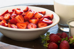 Strawberries with milk and sugar. Strawberries in a bowl with milk and sugar Stock Photo